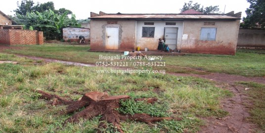 0.13 ACRE PLOT WITH A SMALL HOUSE FOR SALE IN NAMINYA TOWN